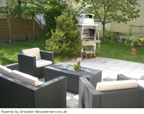 Gartenlounge mit Möbeln/Grill